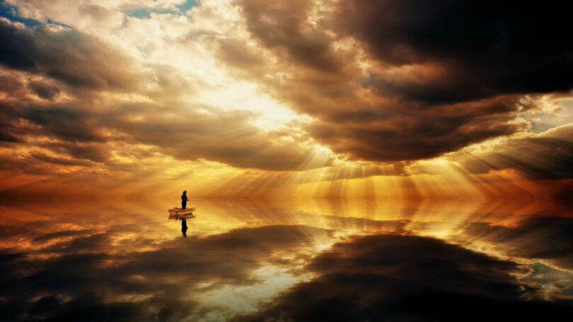 Image of a person fishing in the middle of a silent ocean