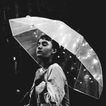 Image of an ambiverted woman holding an umbrella