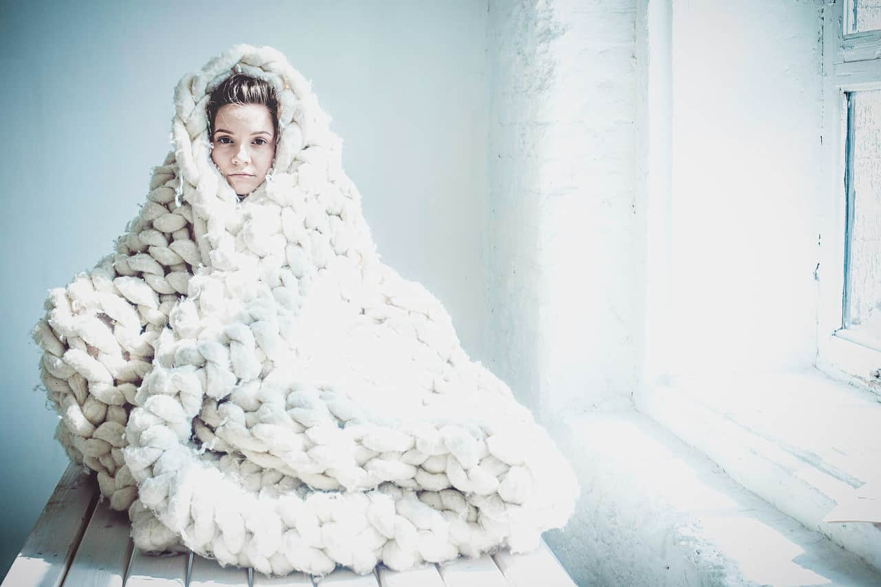 Image of a highly sensitive woman in a blanket