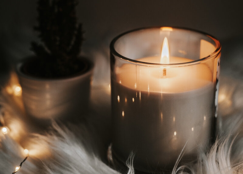 Image of a cozy self-care candle