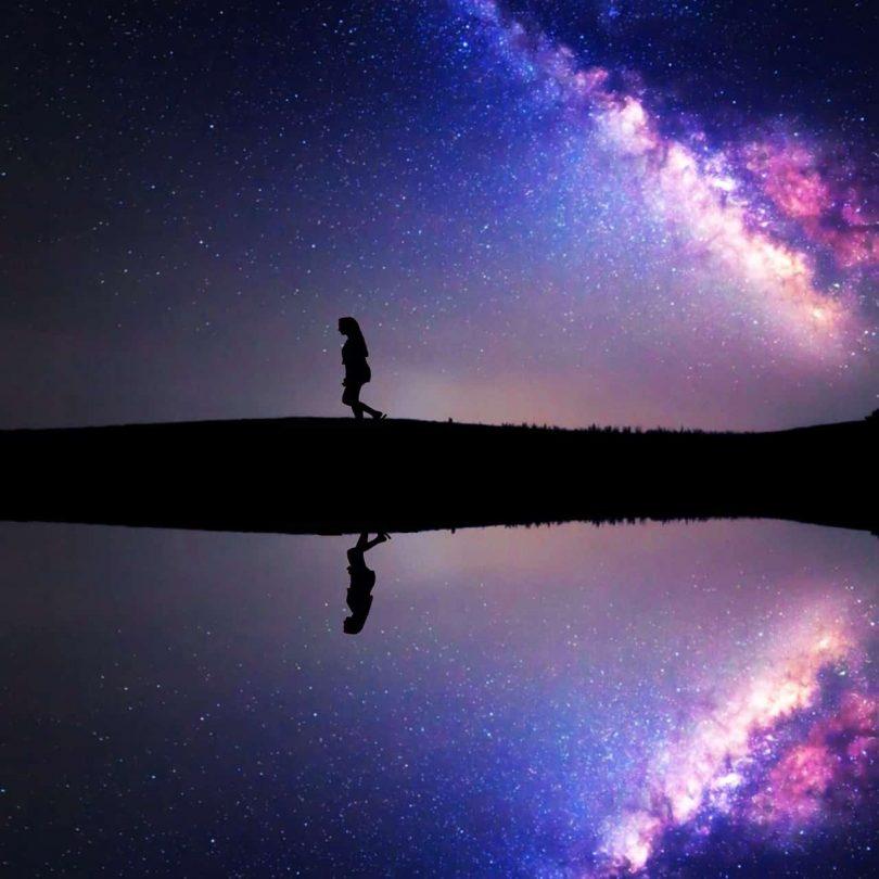 Image of a woman walking under the stars on her spiritual awakening process path