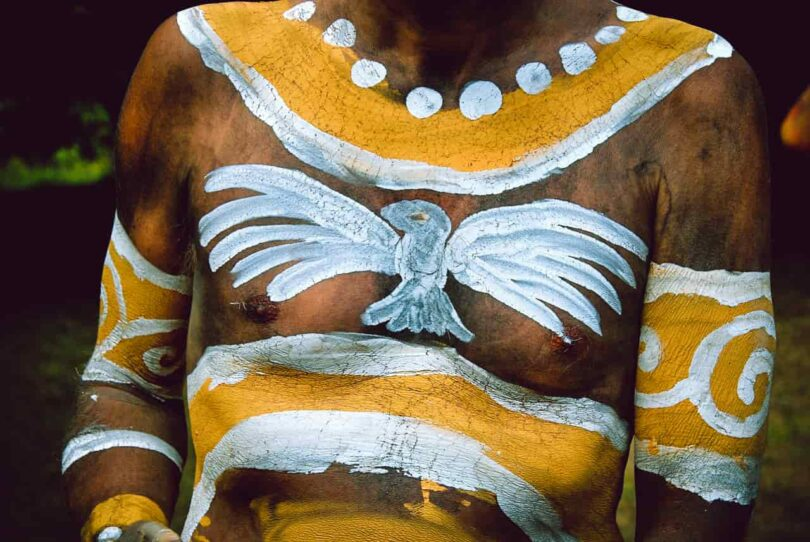 Image of a man with a spirit animal painted on his chest