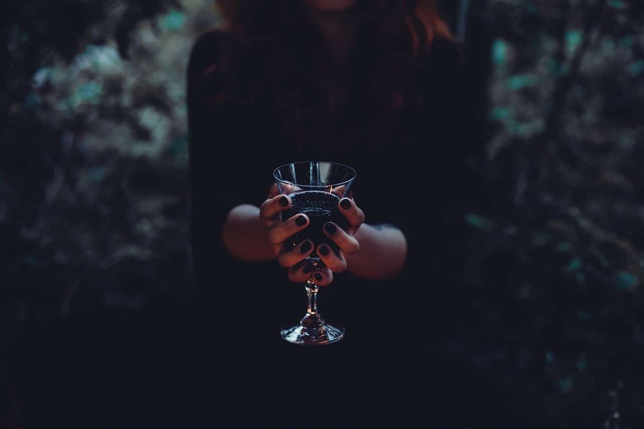 image of a gothic woman holding a cup symbolizing shadow work