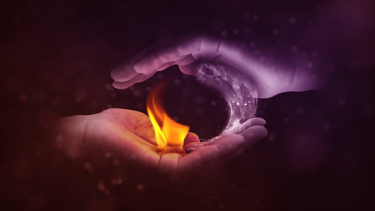 Image of two hands holding fire and water representing the anima and animus