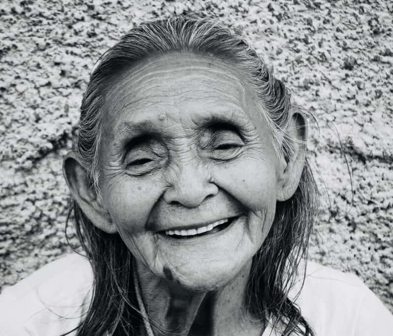 Image of a happy old woman smiling authentically