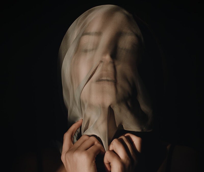 Image of a woman with a veil over her face
