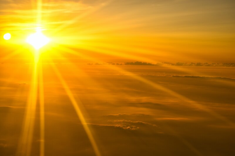 Image of enchanting yellow sunshine above the clouds