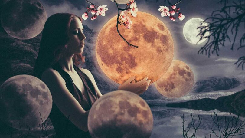 Image of a woman holding a moon experiencing synchronicity