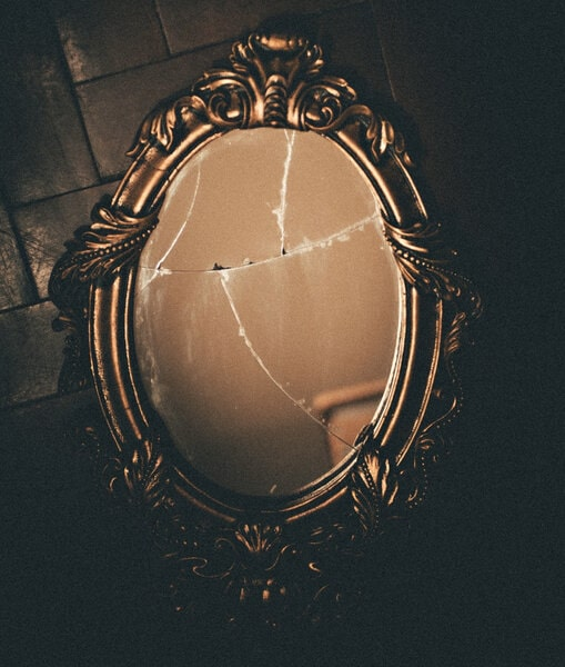Image of a broken mirror symbolic of having a sense of entitlement