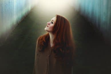 Image of an old soul empath woman looking at the light