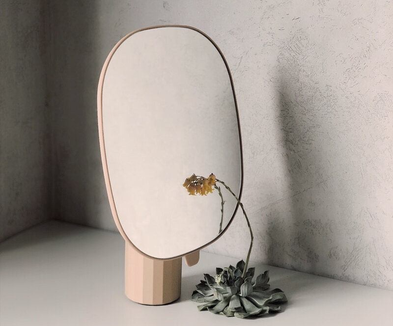 Image of a sad flower reflected in a mirror symbolic of having a sense of entitlement