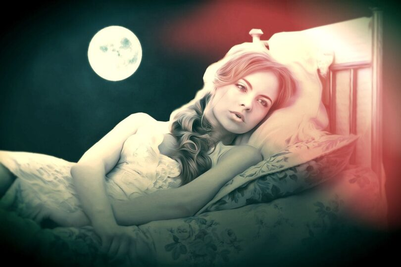 Image of a woman lying down having dreamlike perceptions of anxiety and depression