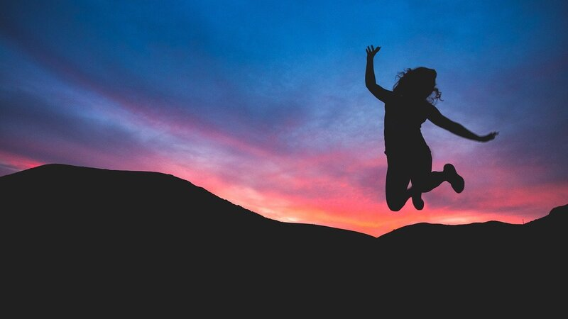 Image of a happy and joyous woman jumping
