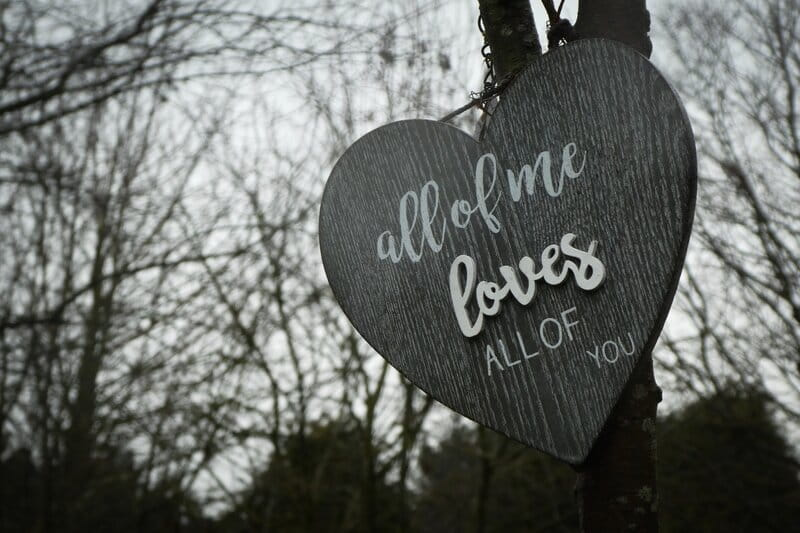 Image of a sign that says All of me loves all of you.