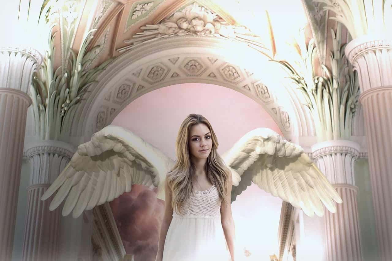 Image of a smiling angelic woman symbolic of spiritual bypassing