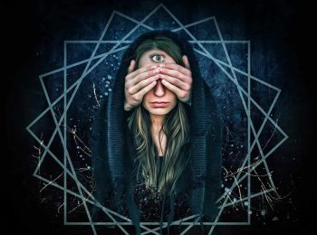 Image of a hooded woman covering her eyes committing spiritual bypassing