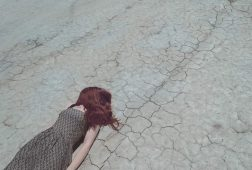 Image of a sad woman on the ground living in the past