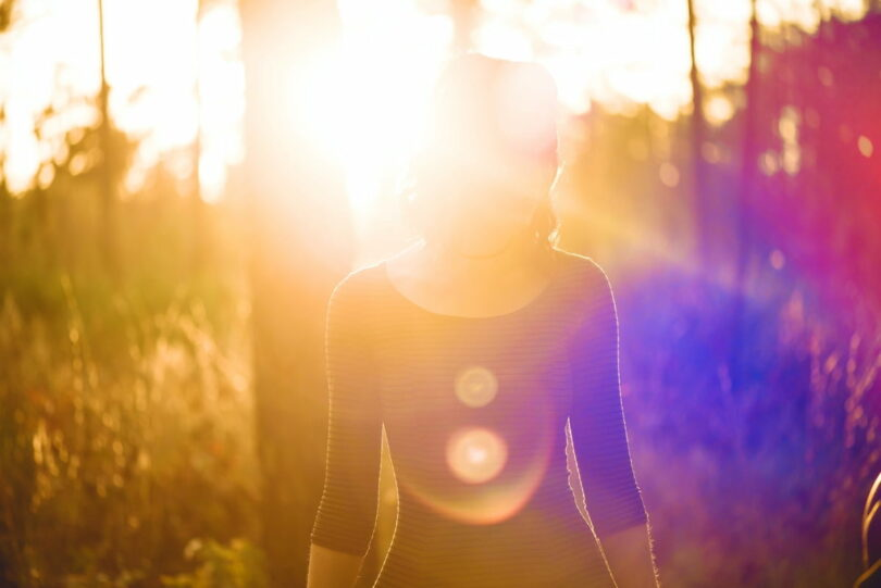 Image of a woman in the sunlight representing spiritual psychology