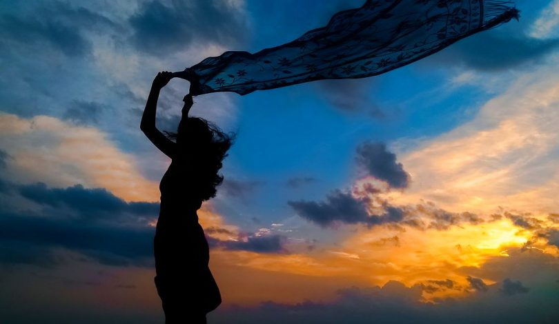 Image of a woman and the sky experiencing inner peace