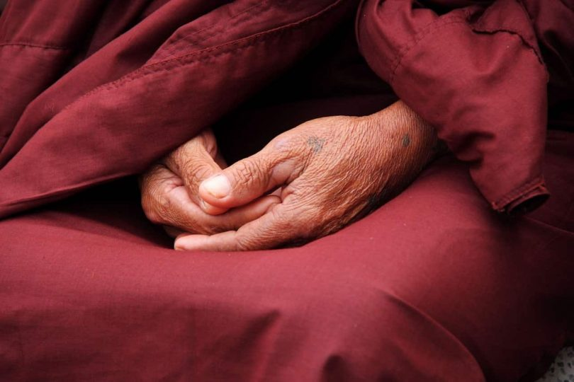 Image of a monk's hands meditating