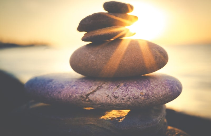 Image of a zen pile of stones on the beach