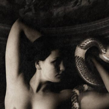 Image of a woman holding a snake