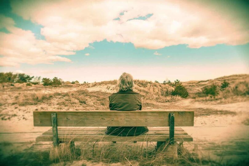 Image of a lonely old soul woman sitting on bench