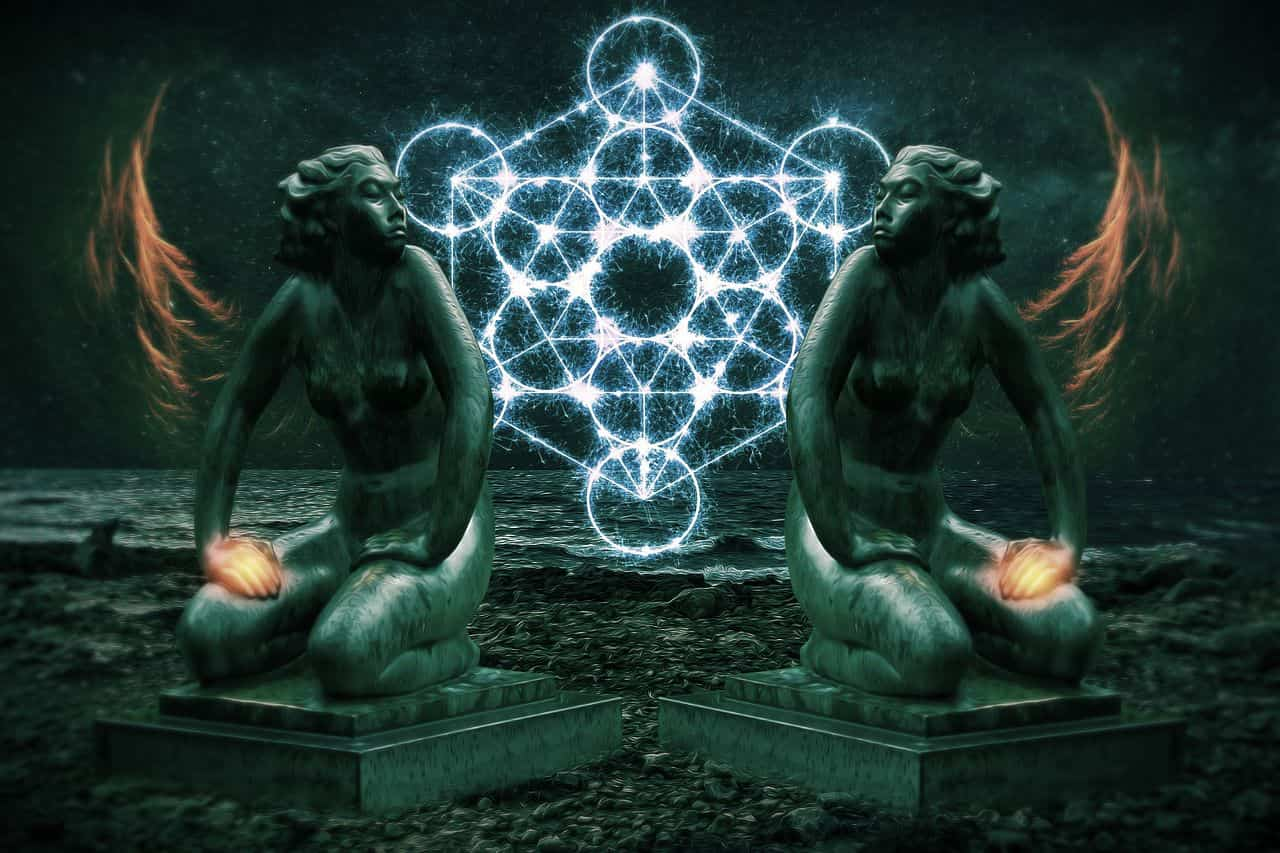 Image of a mystical spiritual alchemy symbol and two statues