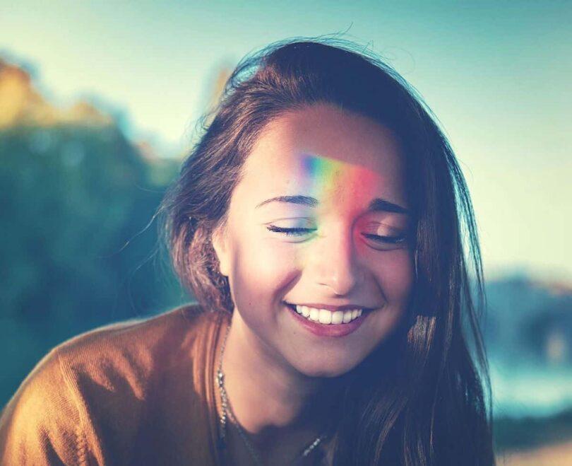 Image of a happy woman undergoing chakra balancing
