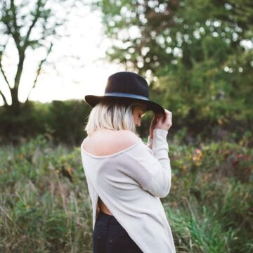 Image of a shy and socially anxious woman hiding her face