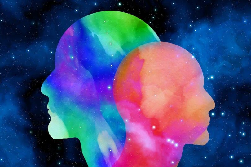 Image of two colorful heads experiencing self awareness