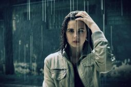 Image of a woman standing and suffering in the rain