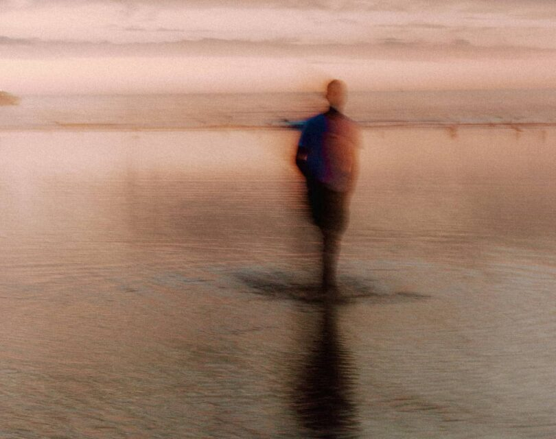 Image of a man in a dusky twilight environment