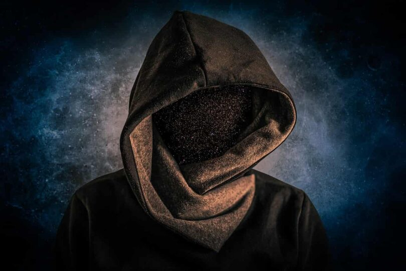 Image of a hooded man with no face symbolizing the ego