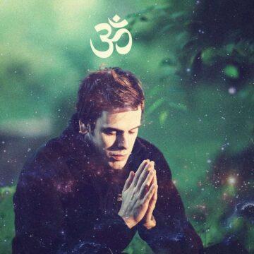 Image of a man praying and saying meditation mantras