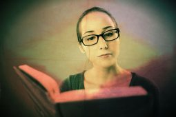 Image of a smart woman reading suffering from the all-knowing disease