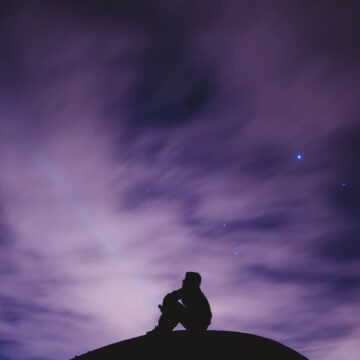 Image of a sad and lonely man looking at the sky