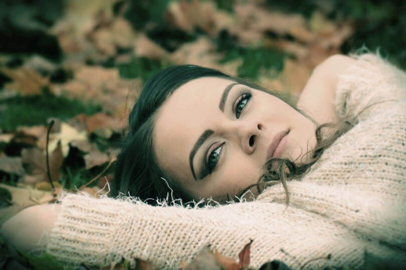 Image of a woman lying down experiencing chronic boredom