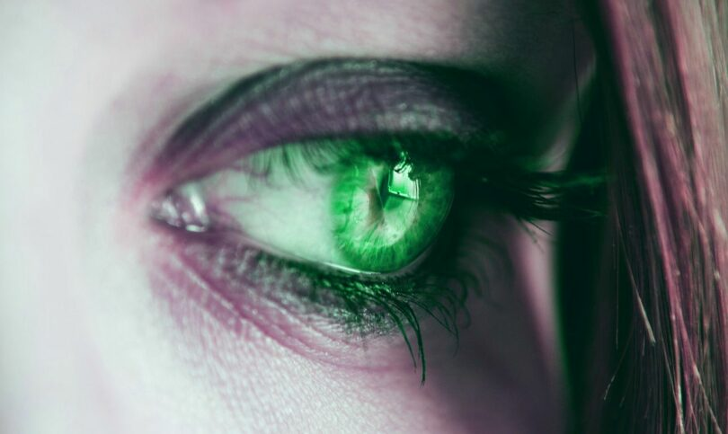 Image of a woman experiencing jealousy with green eyes