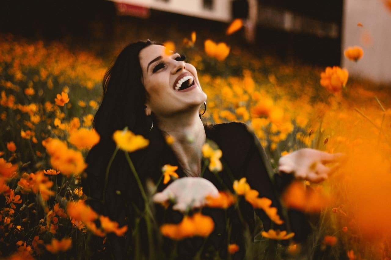 Image of a woman laughing and learning how to love herself more