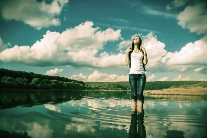 Image of an autotelic woman standing in a lake