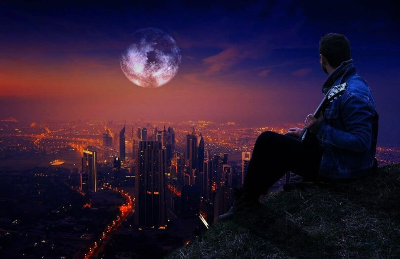 Image of a man overlooking a city having a breathtaking moment of epiphany