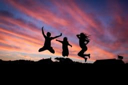 Image of happy people jumping together