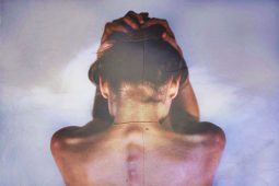 Image of a sensitive empath woman holding her head