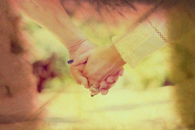 Image of two people holding hands symbolizing the caregiver and caretaker connection