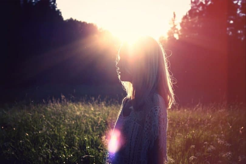Image of a woman in the sunlight experiencing her higher self