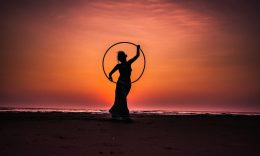 Image of a woman on the beach at sunset symbolic of the higher self