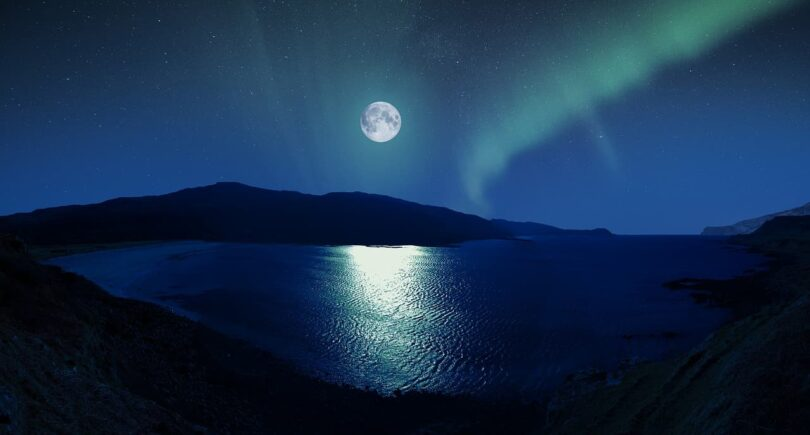 Image of a moon over the water that symbolizes individuation