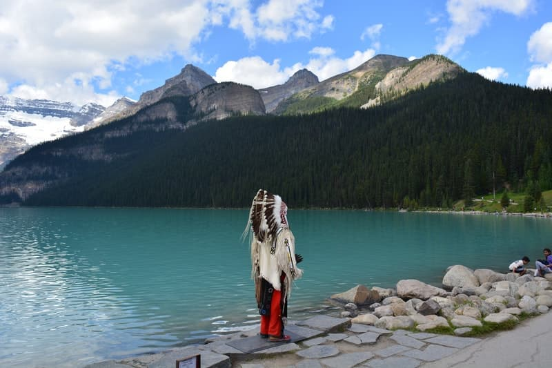 Image of a native American person near a set of mountains