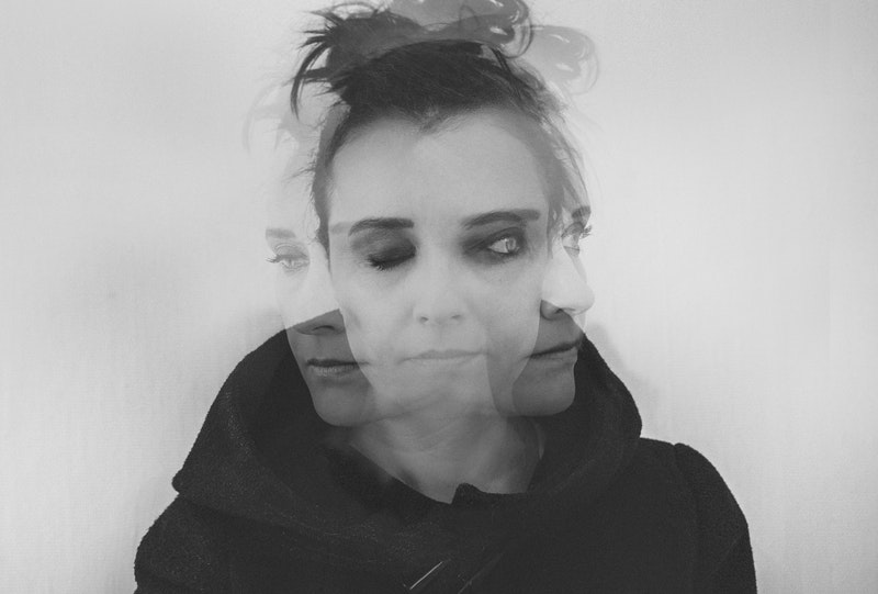 Image of a double exposure woman suffering from soul loss